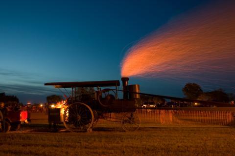 Steam thrasher at dusk